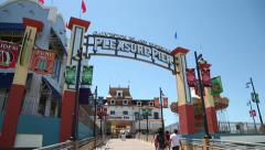 tourists, into galveston island historic pleasure pier - stock footage