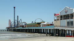 Galveston island historic pleasure pier on sunny day Stock Footage