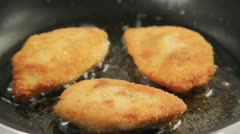 Breaded chicken breasts being prepared Stock Footage