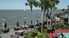 tourists eating outside at kemah boardwalk - stock footage