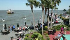 Tourists eating outside at kemah boardwalk Stock Footage