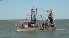 Shrimp boats sail past during the blessing of the fleet Stock Footage