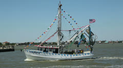 Shrimp boat sails past during the blessing of the fleet Stock Footage