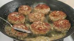 Butter being added to frying burgers Stock Footage