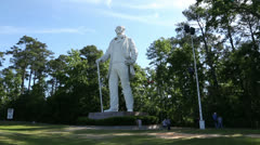 People looking at statue of sam houston in huntsville Stock Footage