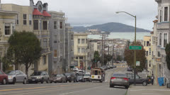 Famous cable car ascending Hyde Street and Alcatraz, San Francisco, California,  Stock Footage