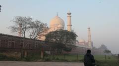 India Taj Mahal with figure at dawn Stock Footage