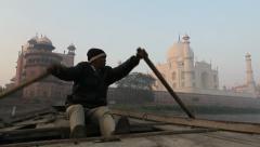 India Taj Mahal at dawn with boatman rowing Stock Footage