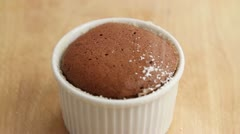Chocolate souffle being dusted with icing sugar Stock Footage