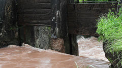 High water at an old weir Stock Footage