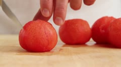 A peeled tomato being quartered and deseeded Stock Footage