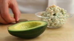 Avocado halves being filled with prawn cocktail Stock Footage