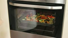 Vegetables being roasted in the oven Stock Footage