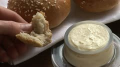 Buttering a piece of sesame bun Stock Footage