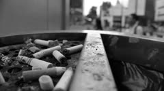 Cigarettes Burning in Ash Tray Black and White Stock Footage