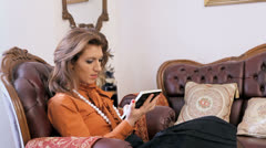 Lady reading a book on a sofa, dreaming Stock Footage
