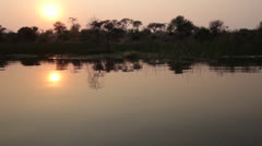 Serene tracking of river sunset in Africa. - stock footage