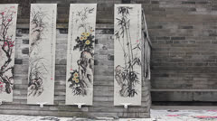 Chinese painting works selled in street Stock Footage