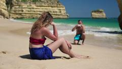 Couple taking photo with cellphone on beautiful beach HD Stock Footage