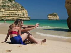 Stock Video Footage of Couple taking photo with cellphone on beautiful beach NTSC