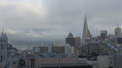 Aerial view of Oakland Bay Bridge,Financial District in fog, San Francisco Stock Footage