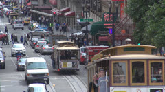 Busy traffic street central city San Francisco day CA California USA cable car Stock Footage