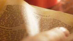 Turning pages of Old Testament Stock Footage