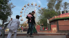 Stock Video Footage of Agra craft fair ferris wheel and people
