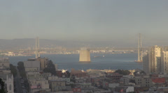 Aerial view of Oakland Bay Bridge, Financial District in sunset,San Francisco Stock Footage