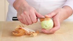 An onion being peeled and finely chopped Stock Footage