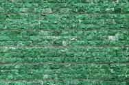 Stock Illustration of wall of stone in green tint
