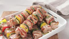 Grilled meat and vegetable kebabs being sprinkled with salt Stock Footage