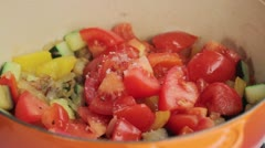 Mixed vegetables being seasoned in a pan Stock Footage