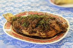 Stock Photo of fried fish with chili sauce
