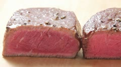 Three differently done steaks Stock Footage