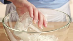 Flour and cornflour being placed in a glass bowl Stock Footage