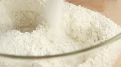 Baking powder being added to flour Stock Footage