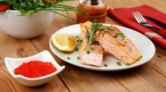 Roasted norwegian salmon chunks with lemon and vegetable salad Stock Footage