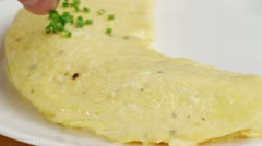 An omelette being sprinkled with chives Stock Footage