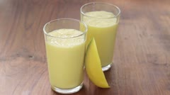 Two glasses of mango lassi Stock Footage