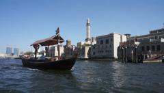 Passing Abra boat taxi Dubai Creek Stock Footage