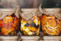 Feta cheese and olives in a jars Stock Photos