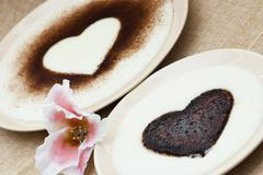 Sweet hearts in semolina pudding with flower of sugar Stock Photos