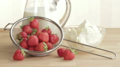 Fresh strawberries in a sieve with milk and vanilla ice cream Stock Footage
