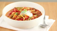Solyanka (Eastern European meat stew with vegetables) in a soup bowl Stock Footage