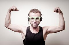 Hipster stylish fashion blonde man with headphones Stock Photos