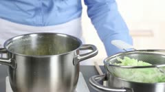 Blanched savoy cabbage being stirred into mashed potatoes Stock Footage