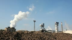 Proccesing sugar beet in sugar refinery. - stock footage