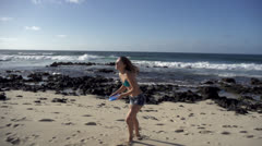 Stock footage Hawaii -beautiful woman throws frisbee on beach Stock Footage