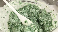 Spinach and ricotta being mixed Stock Footage